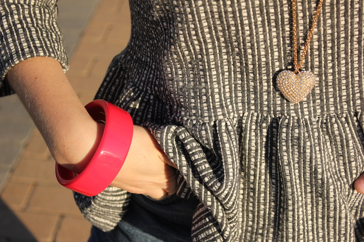 Allie's red bangle and heart necklace