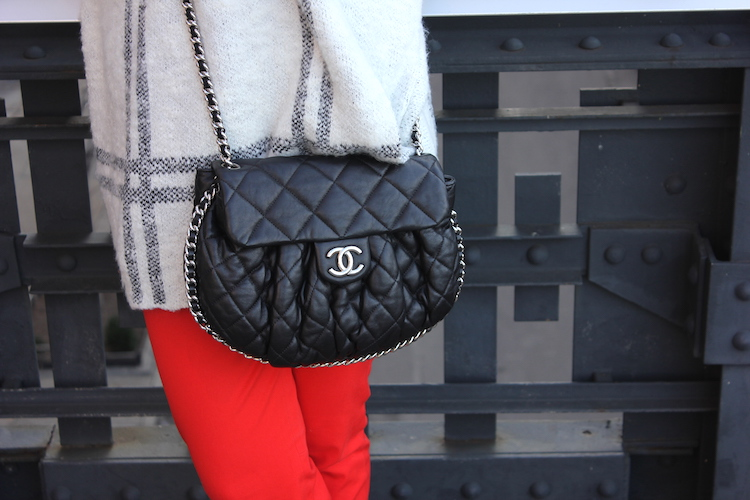 Black Chanel bag and red pants