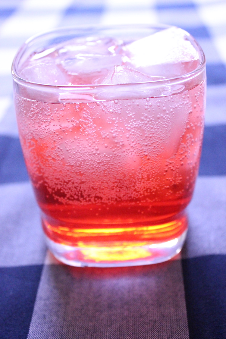 A tall glass of fizzy Campari and soda cocktail