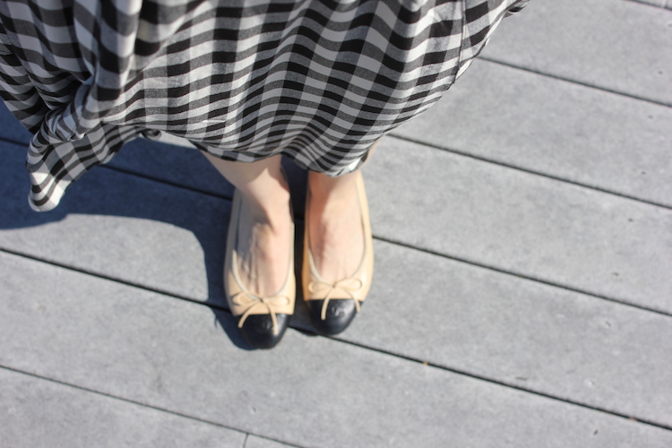 Downward shot of Chanel ballet flats