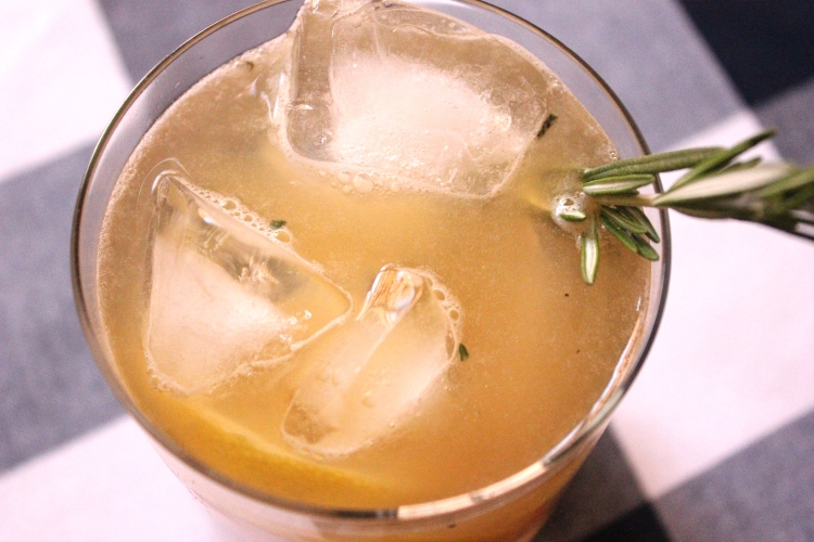 A sour made with bourbon, rosemary, maple syrup, and lemon