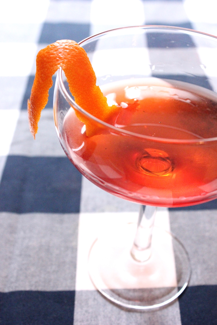 A classic negroni cocktail with an orange twist