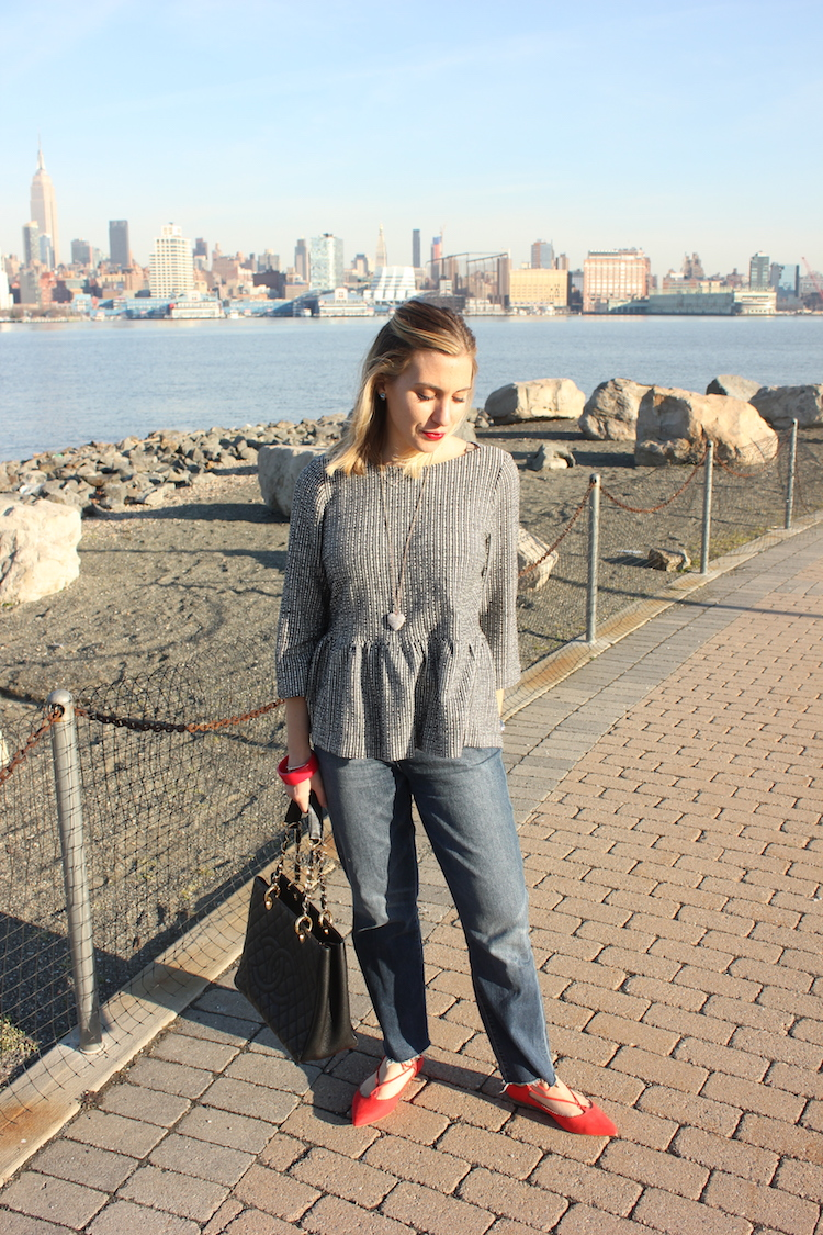 Allie wearing peplum in front of the NYC skyline