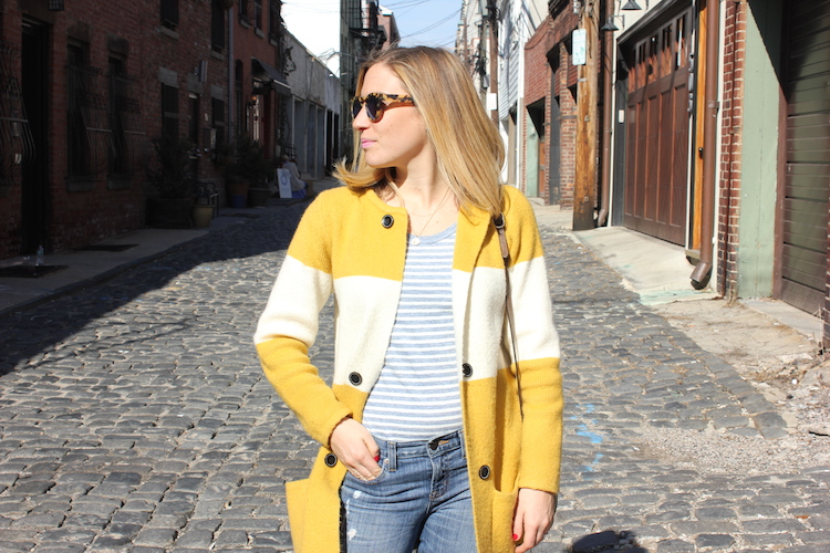 Allie looking right in an Anthropologie cardigan as she walks down Court Street in Hoboken, New Jersey