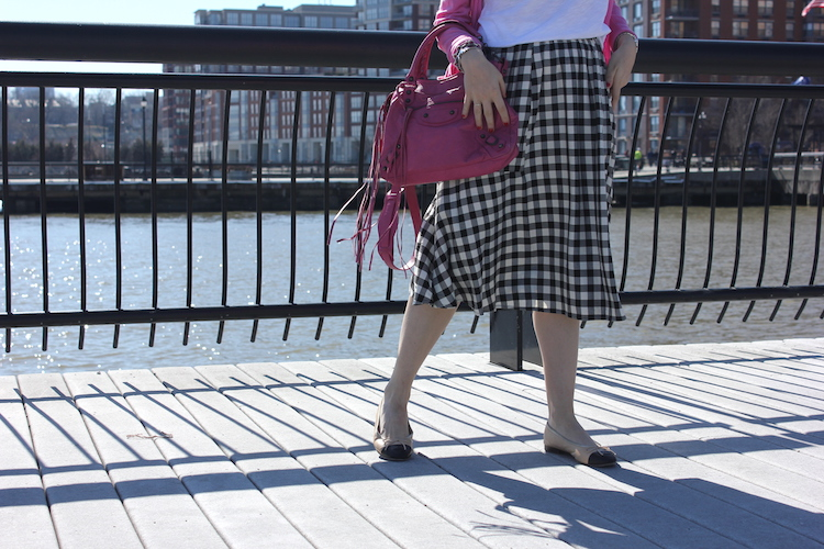 Shot of Allie's pink Balenciaga, long buffalo check skirt, and Chanel shoes