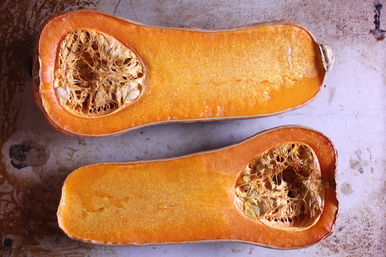 Two roasted halves of a butternut squash