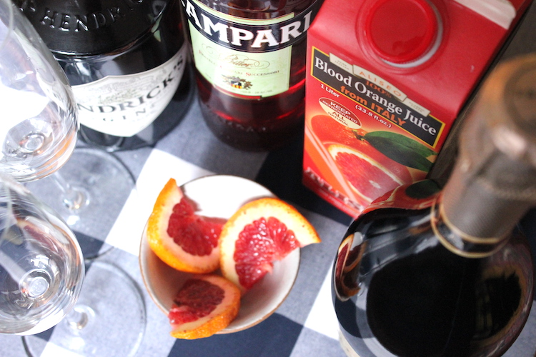 The ingredients for a Sicilian 75: blood oranges, Prosecco, Campari, and gin