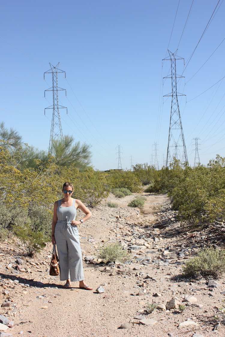 A portrait shot of how to wear a summer jumpsuit