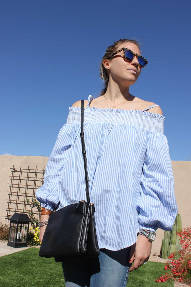 Allie with a blue-and-white striped shirt off-shoulder and