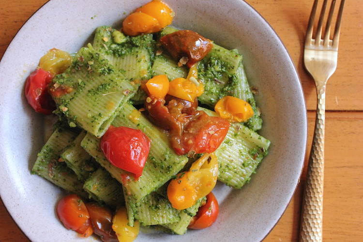 Pasta with pesto and colorful tomatoes